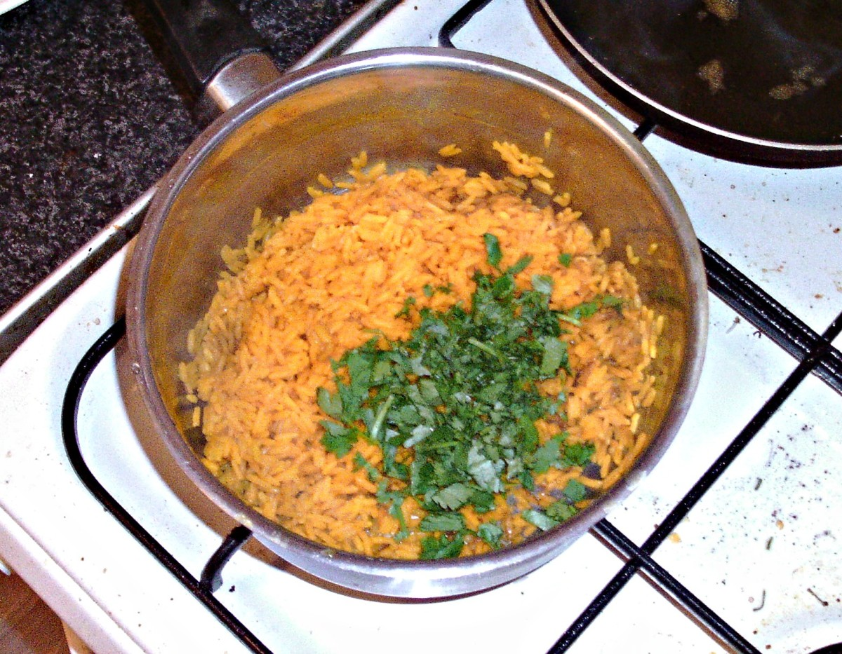Chopped coriander/cilantro is added to turmeric rice