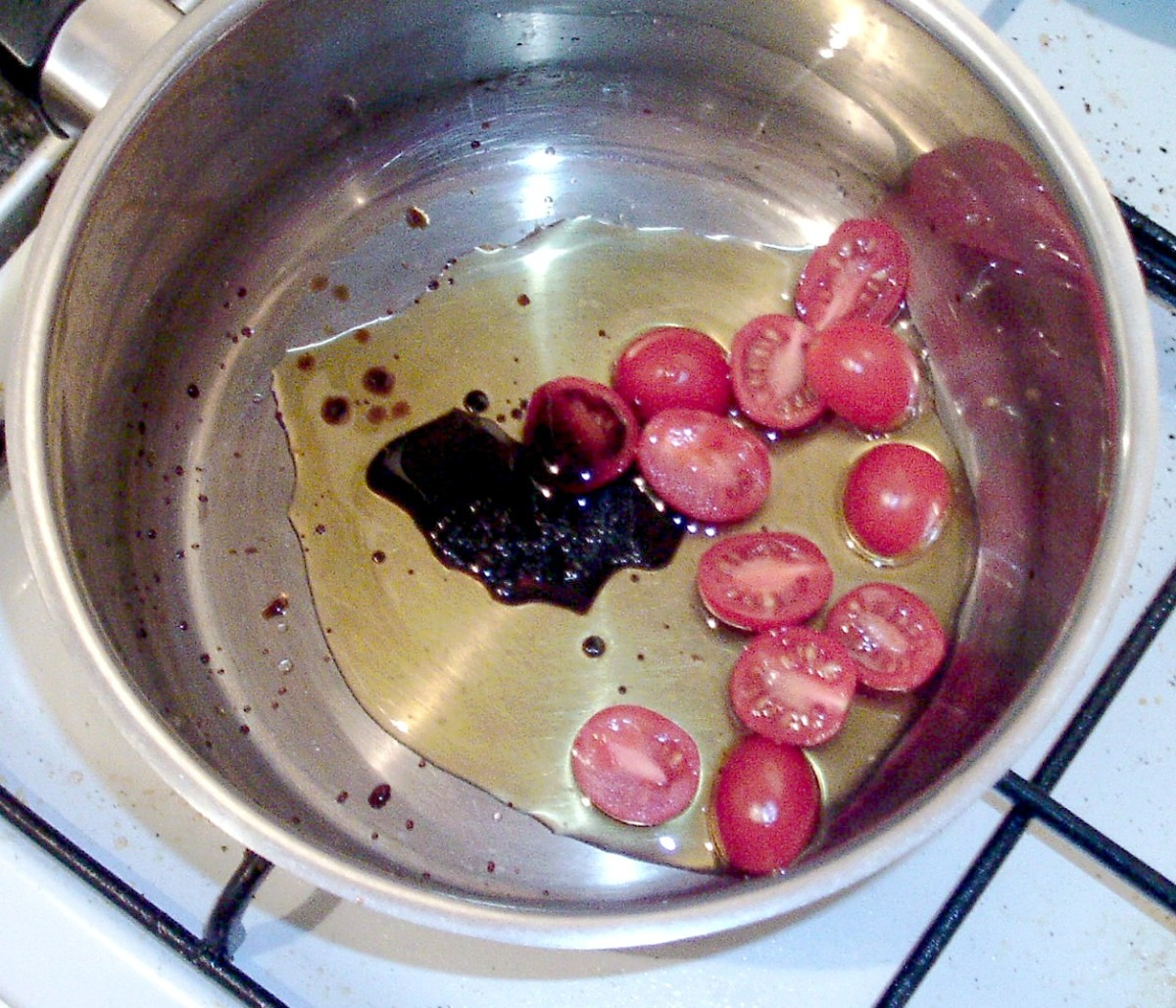 Starting to saute tomatoes in balsamic vinegar and olive oil