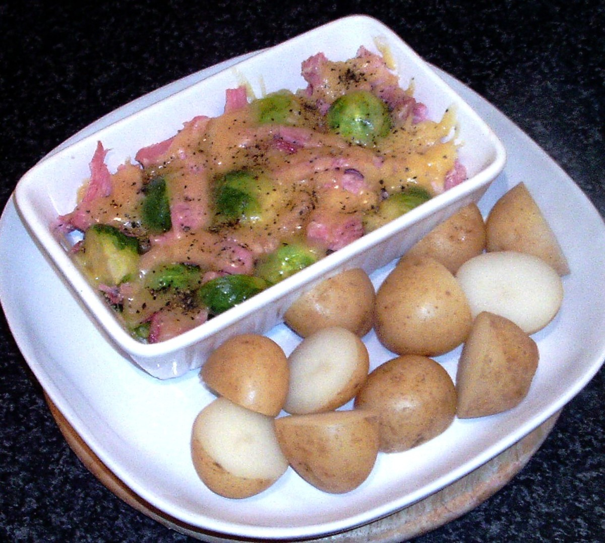 Cheese and ham Brussels sprouts are served with new potatoes