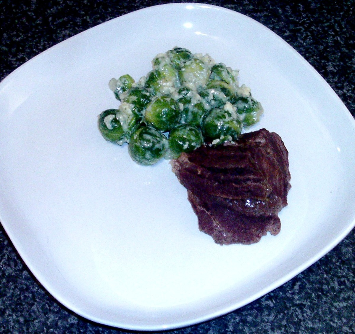 Plated ox cheeks and sprouts in blue cheese
