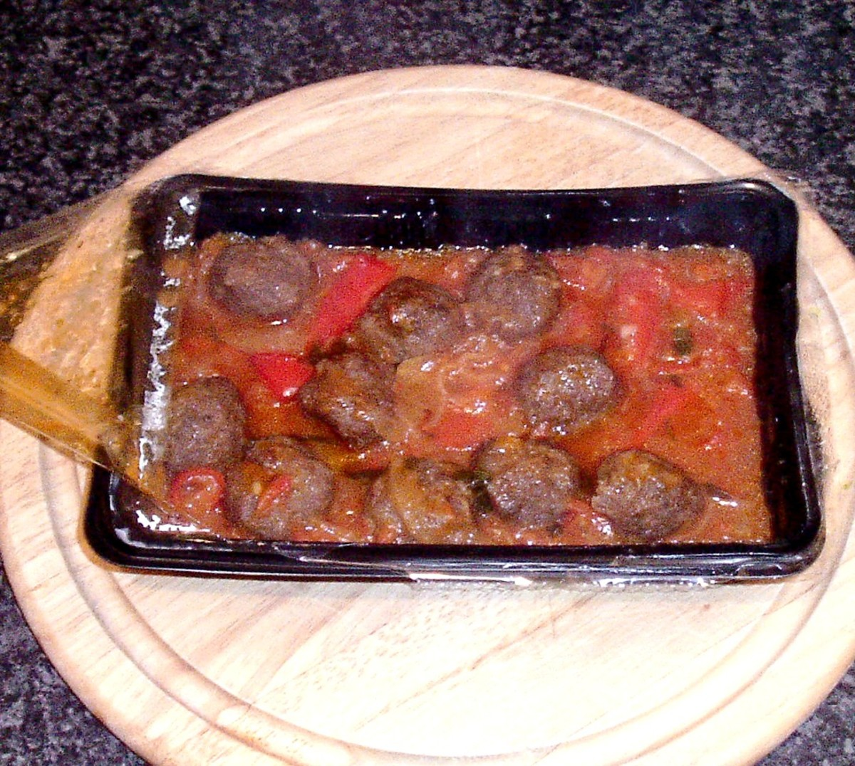 Wagyu beef meatballs in tomato salsa are removed from microwave