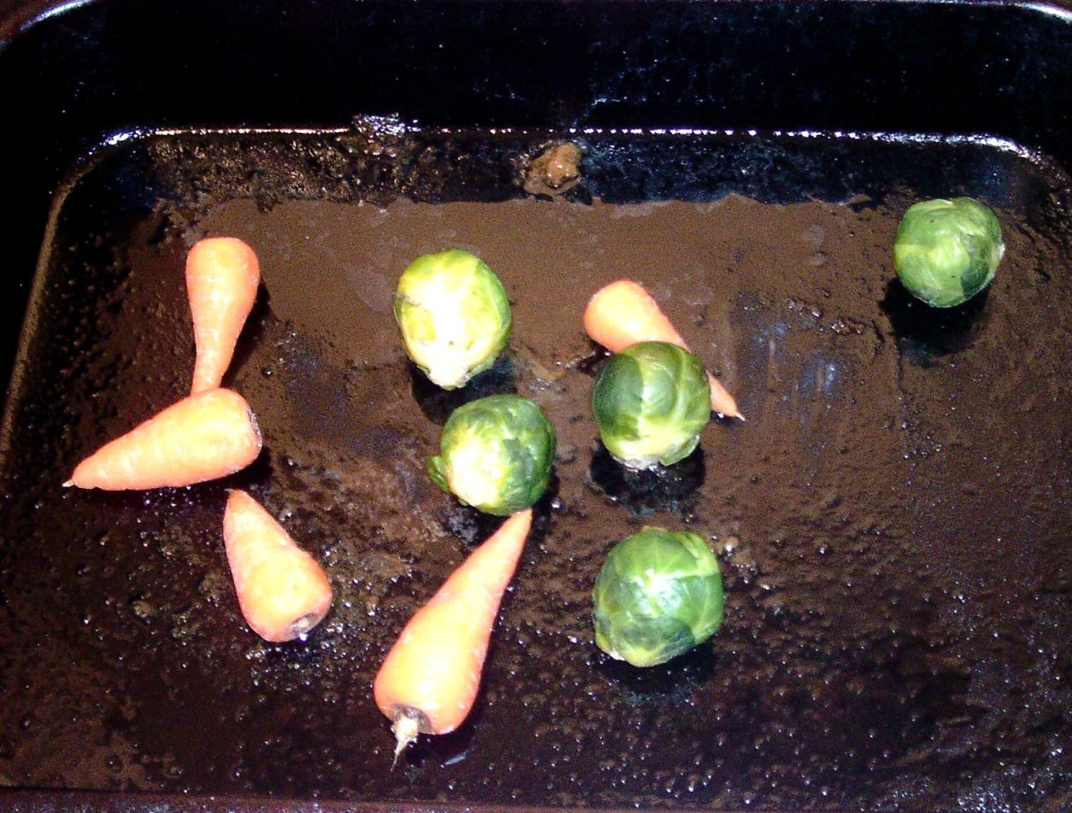 Sprouts and carrots added to hot roast chicken juices