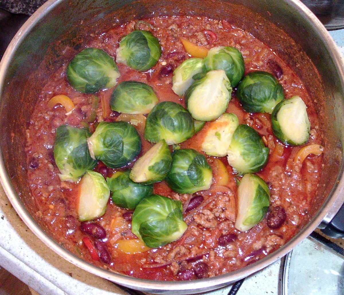 Halved sprouts are added to chilli