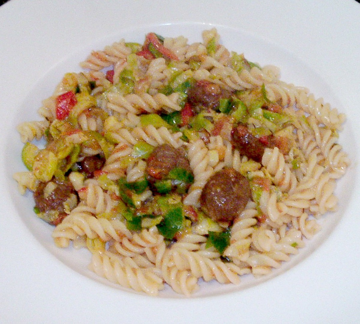 Shredded Brussels sprouts and fusilli pasta are infused with wagyu beef meatballs in tomato salsa sauce