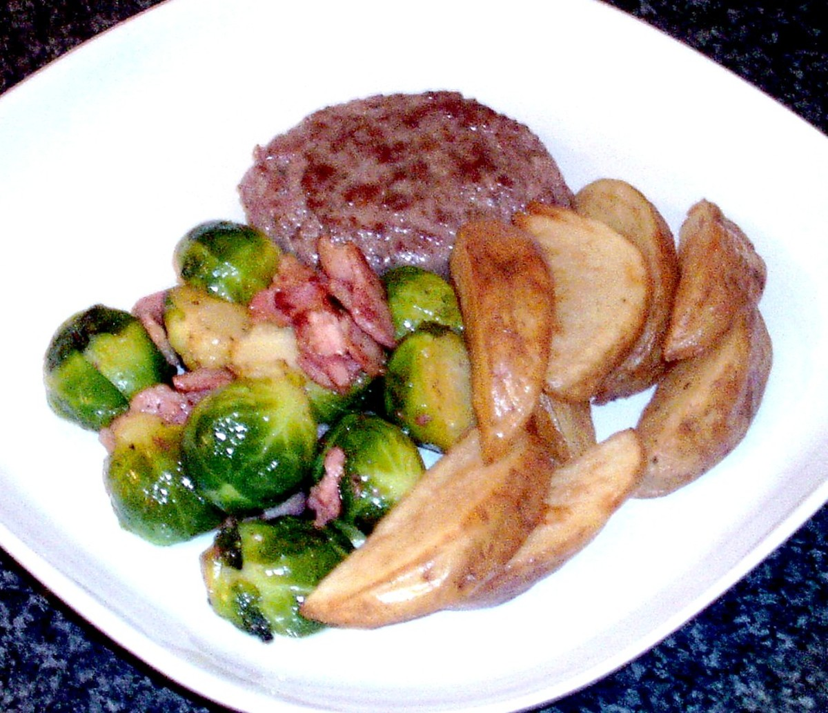 Plated burger, sprouts, bacon and wedges