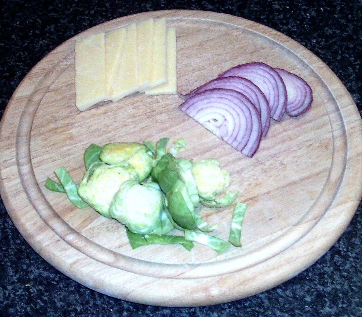 Sliced sprouts, cheese and onion