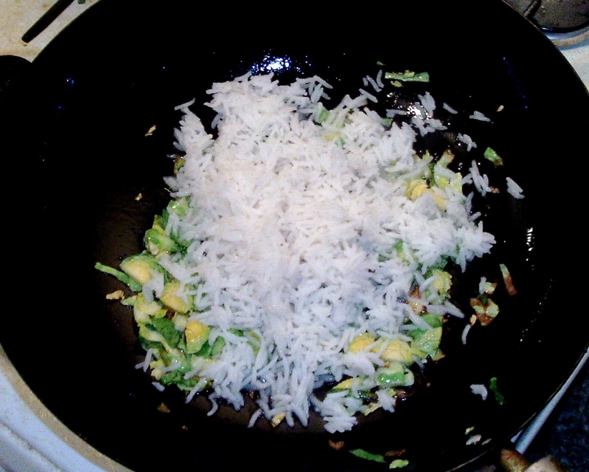 Cooled rice is added to stir fried sprouts
