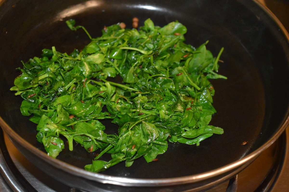 Starting to stir-cook the leaves.