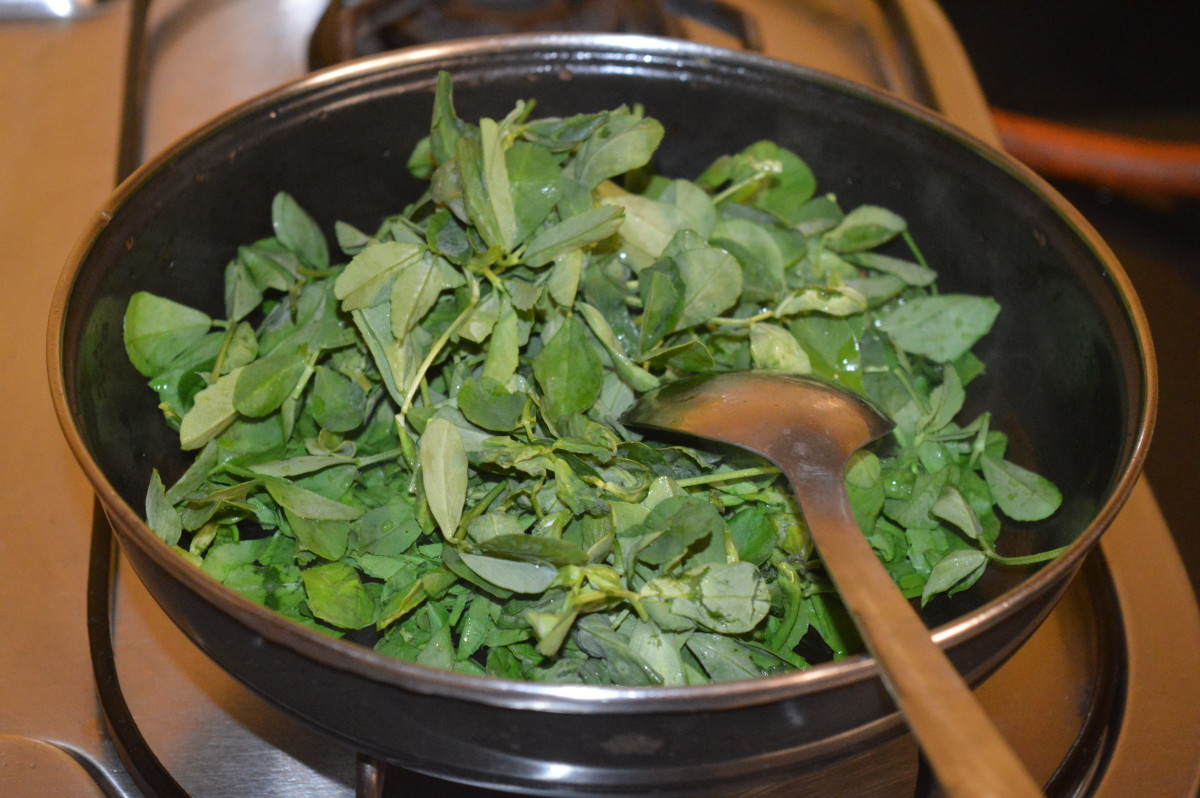 Step three: Throw in fenugreek leaves(methi). Stir-cook them.