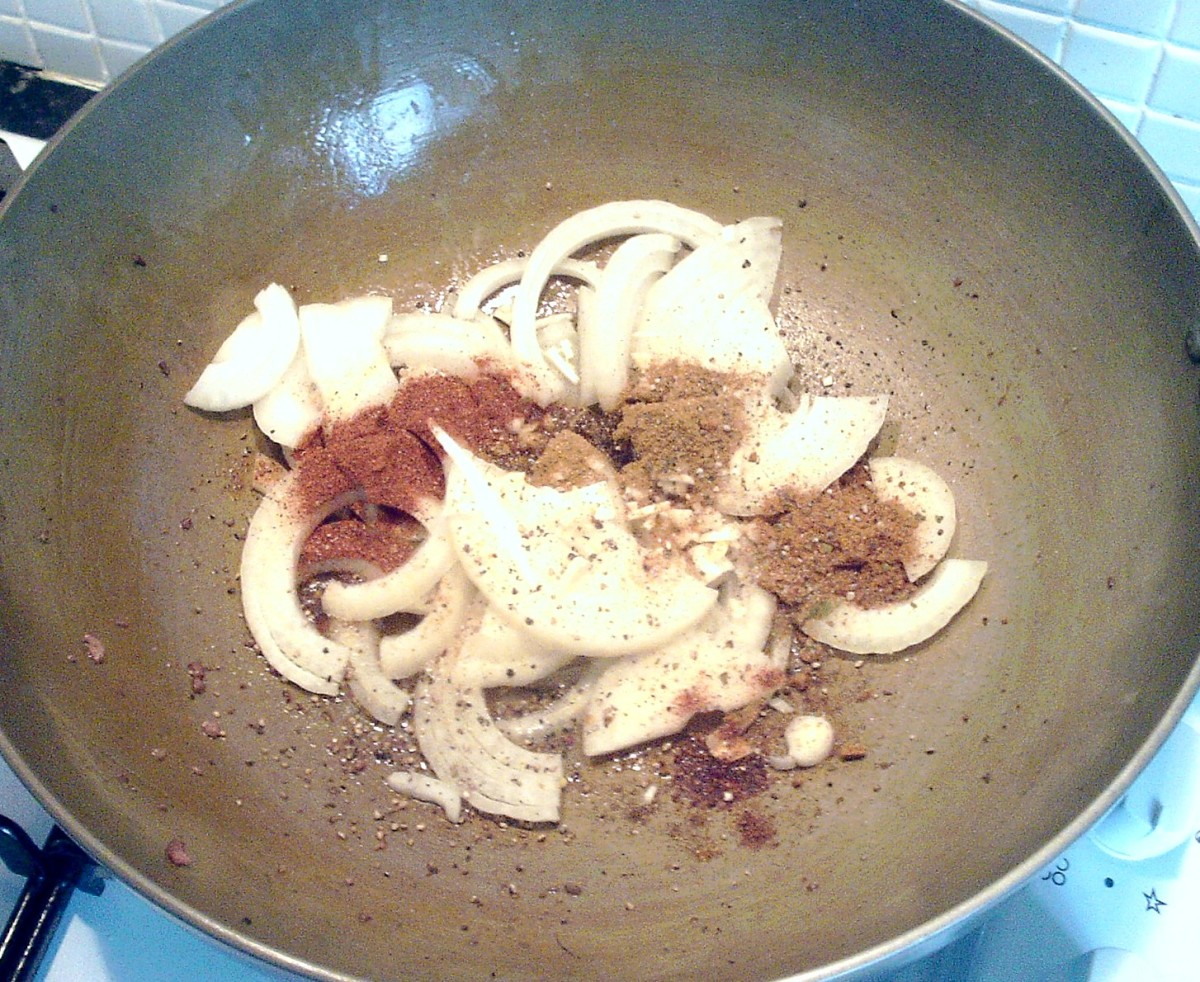Onion, garlic and spices are added to karahi