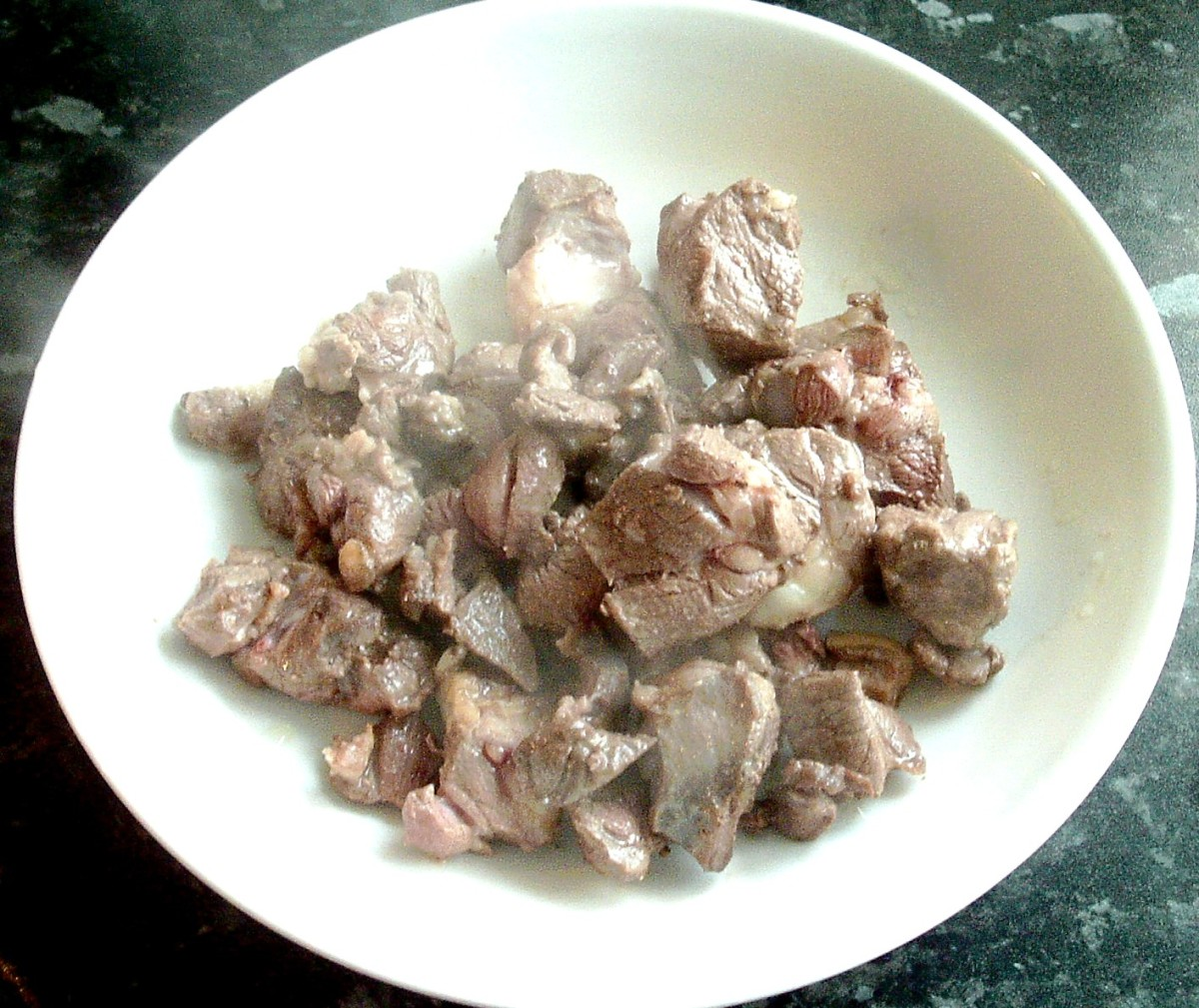Browned and sealed goat meat