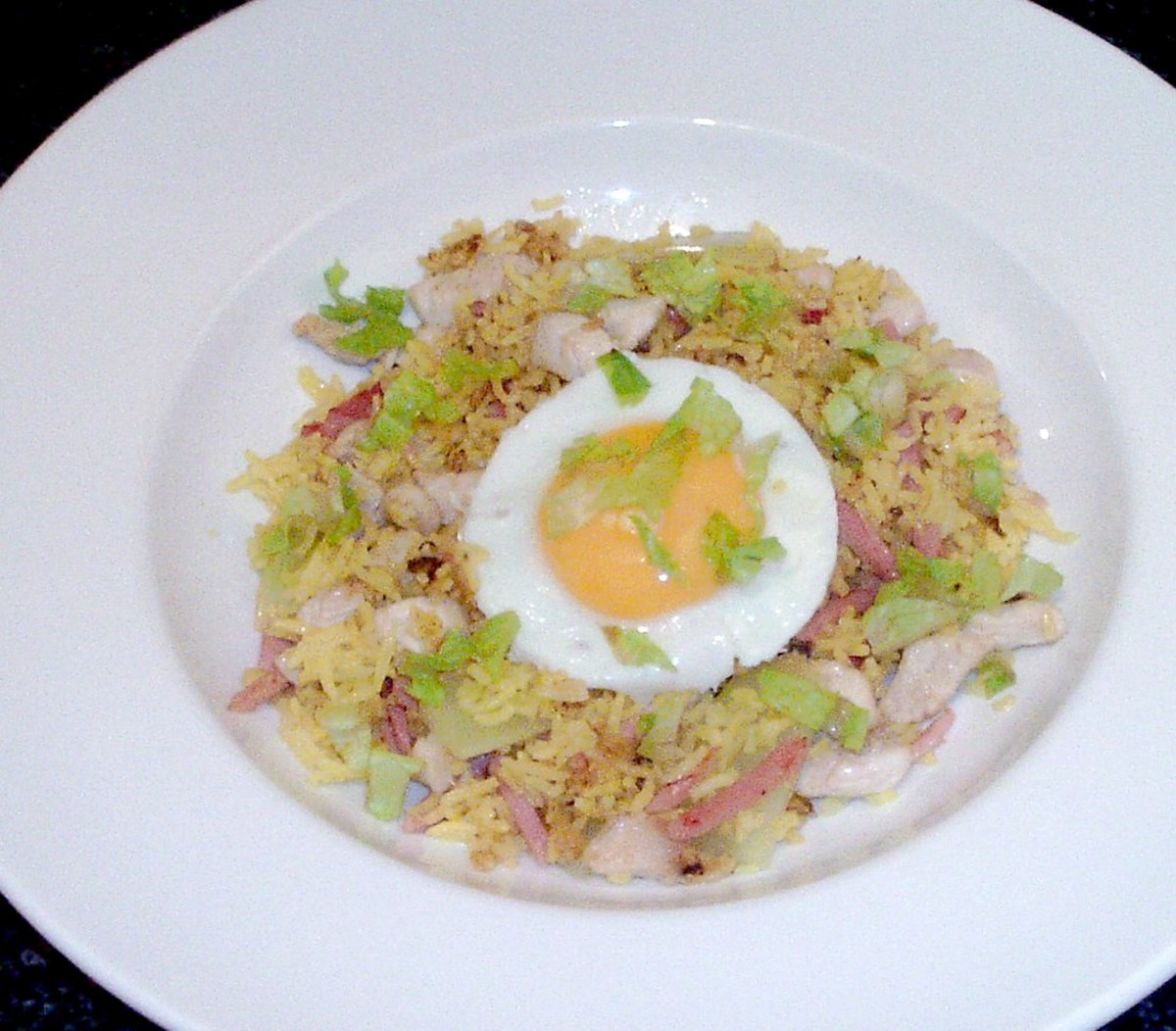 Celtuce chicken and ham fried rice is served with a fried egg