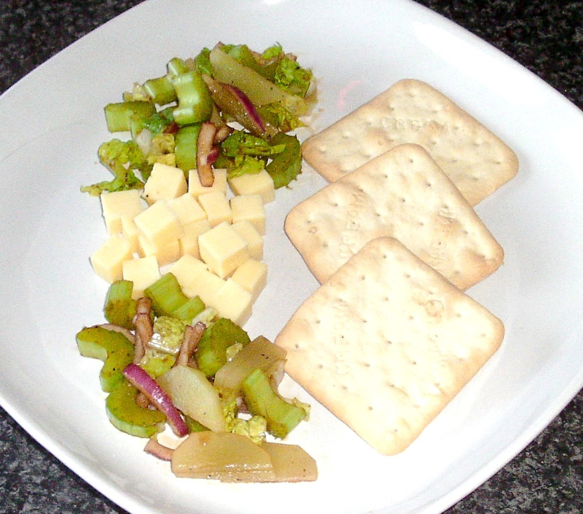 Celtuce and celery balsamic salad with cheddar creese and crackers