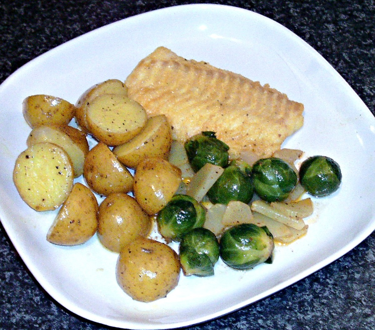 Chilli spiced sauteed celtuce and Brussels sprouts with turmeric spiced cod and potatoes