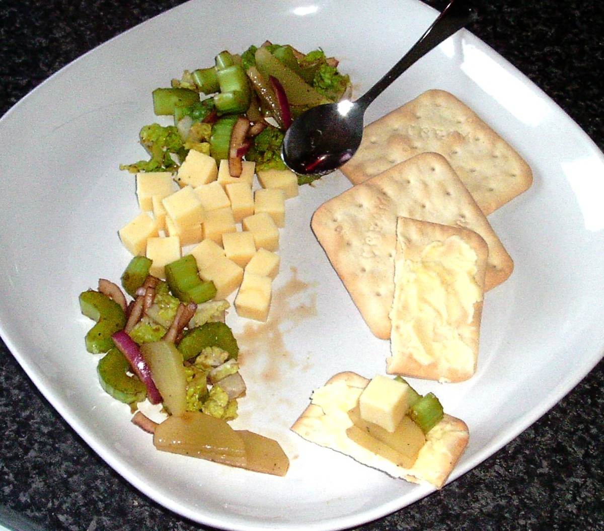 Enjoying celtuce and celery salad with cheese and crakcers