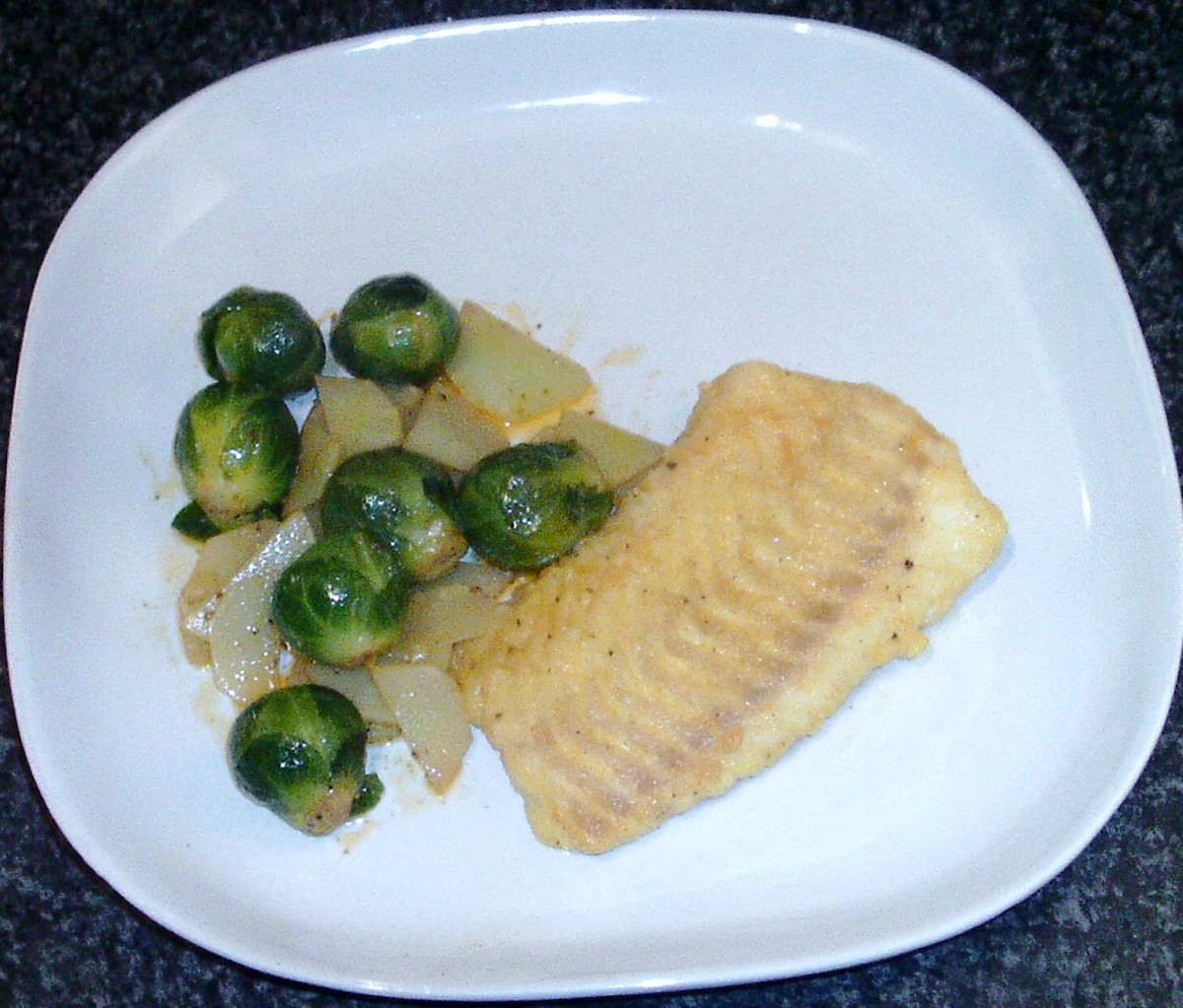 Cod, celtuce and sprouts are plated