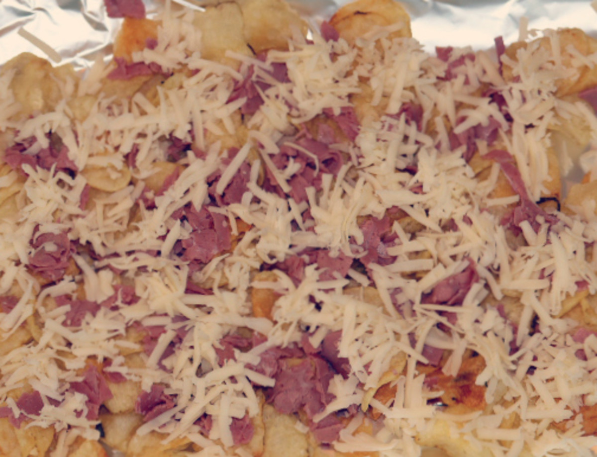Kettle Chips, Swiss Cheese, and Corned Beef Layered on Baking Sheet