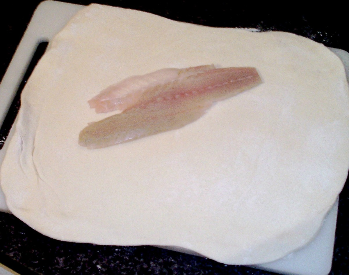 Sea bass fillet is laid on rolled pastry
