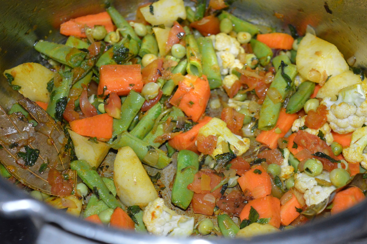 Step five: Add vegetables. Also, add some salt. Continue stir-cooking for a minute.