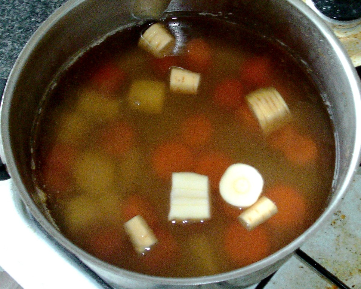 Chopped carrots and parsnips are added to strained stock