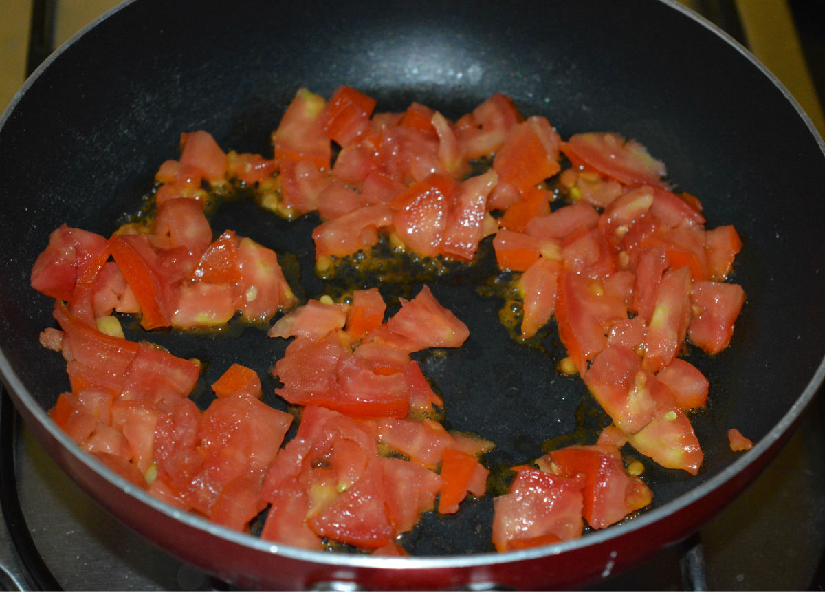 Step four: Saute chopped tomatoes till they are mushy.