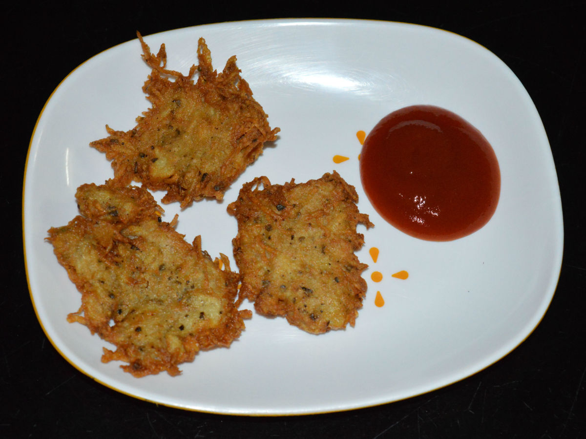 Now, your favorite hash browns are ready to munch! Serve a few of them hot in a plate with tomato ketchup on the side. Enjoy eating this awesome snack.