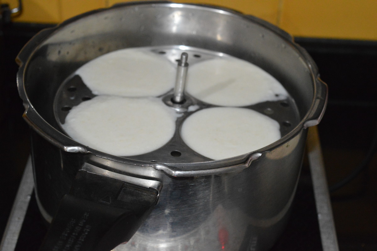 Step eight: Place the idli stand inside the steamer. Close the lid. If you are using a pressure cooker, don't place the weight.
