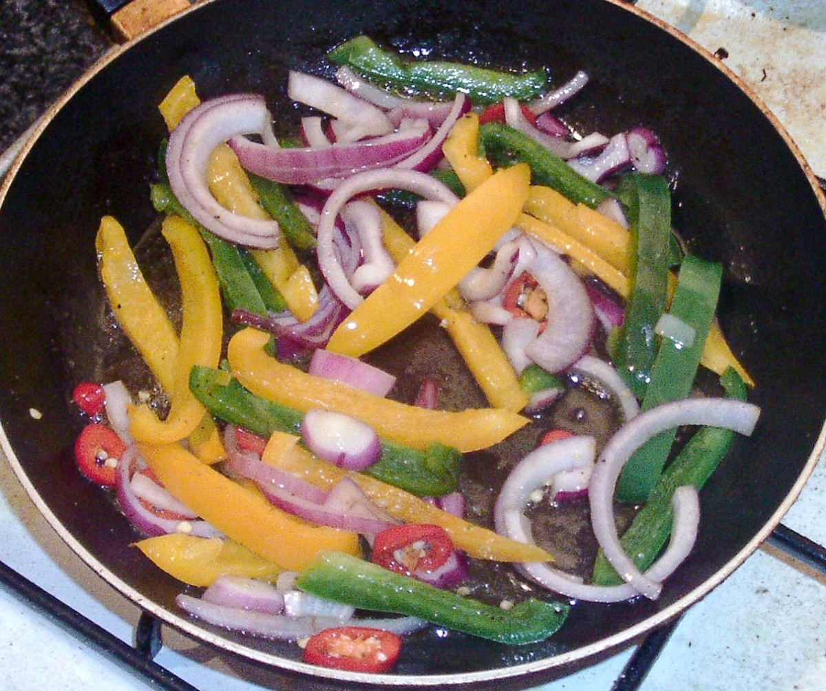 Peppers and onions are quickly stir fried