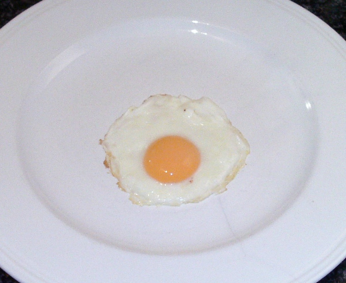 Fried egg is lifted to a plate