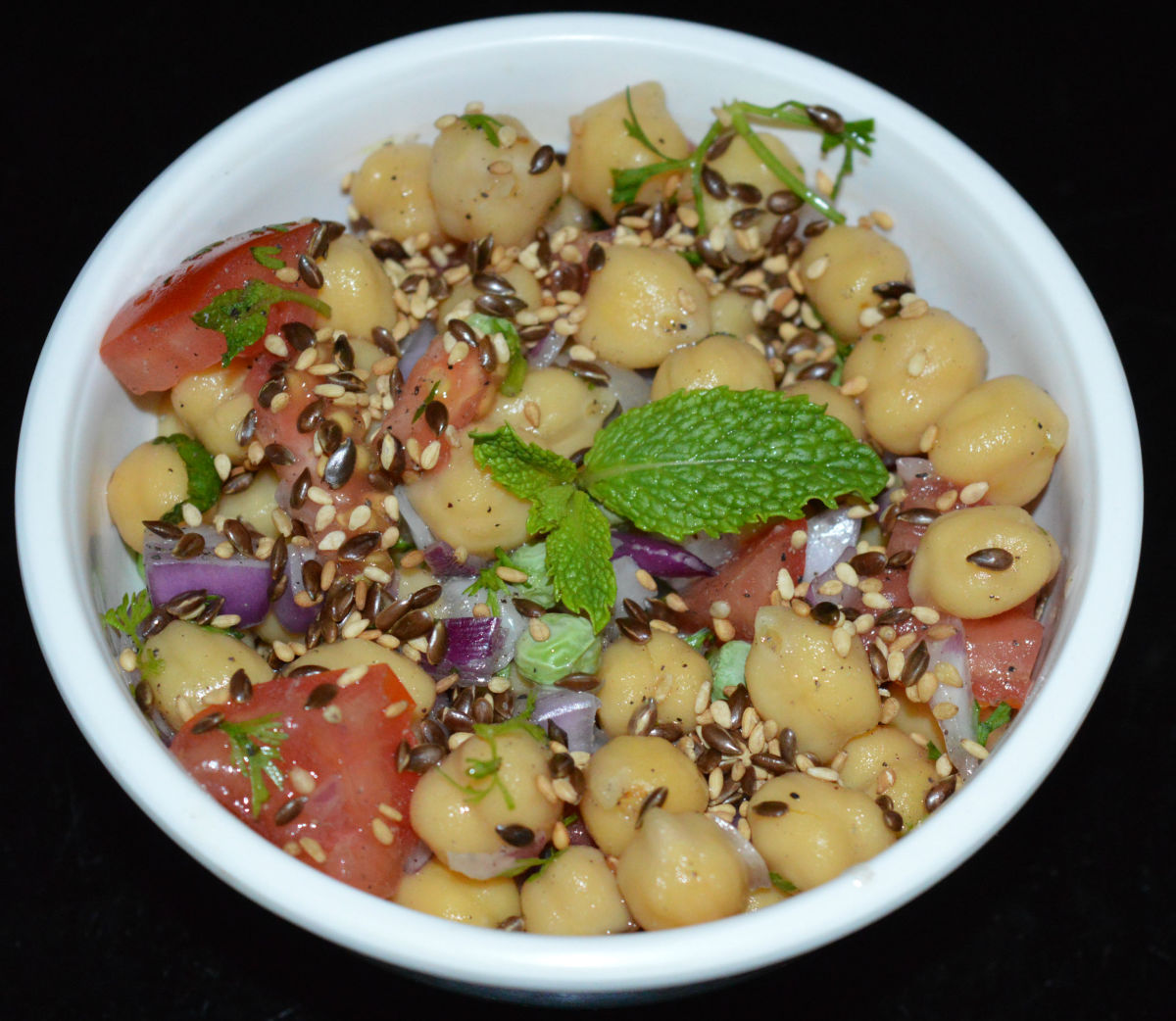 Step five: Serve 2-3 tablespoons of this awesome salad topped with some roasted sesame seeds and flax seeds. Enjoy eating!