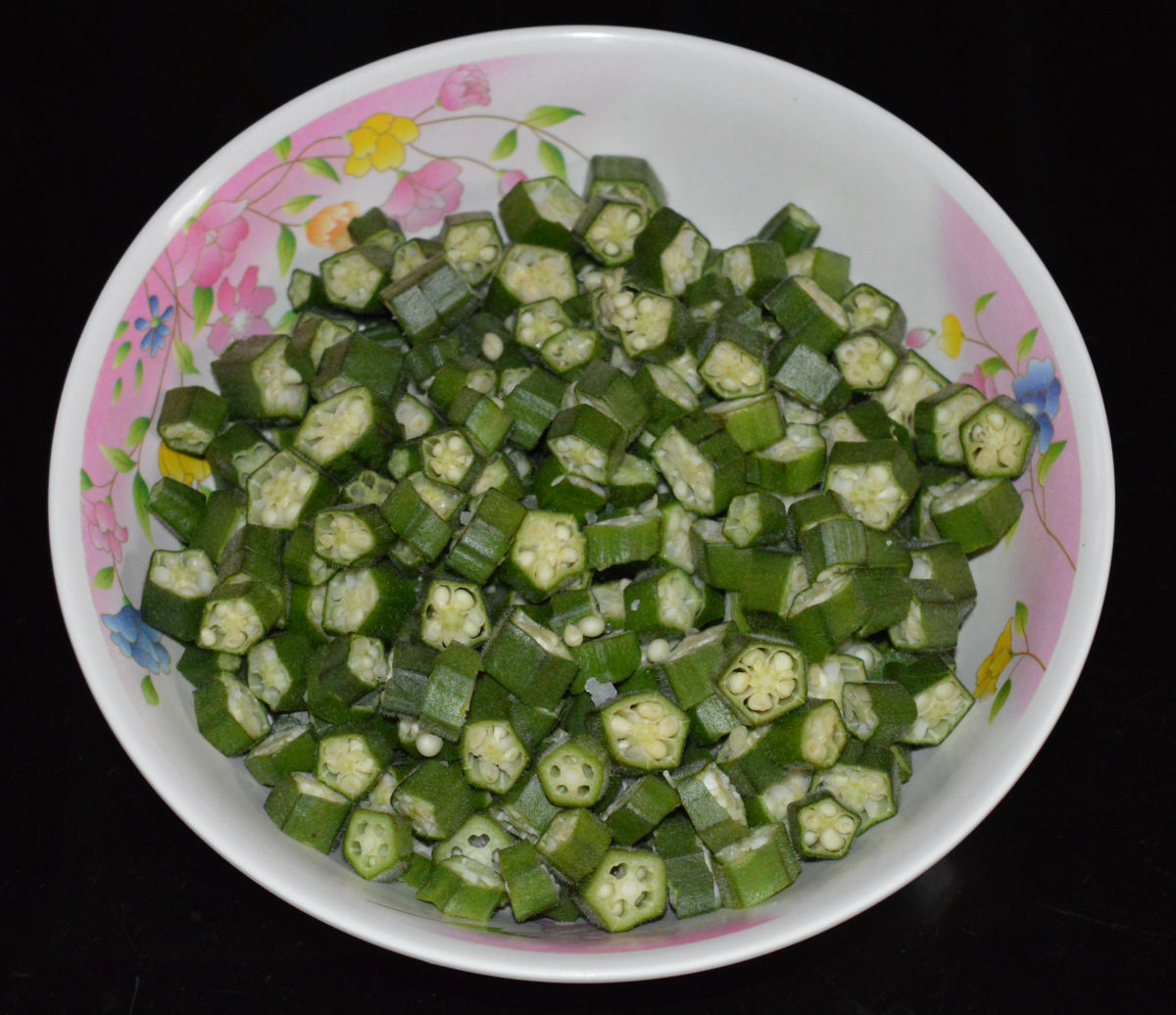 Step 1: Make thin slices of okra. Place them in a mixing bowl.
