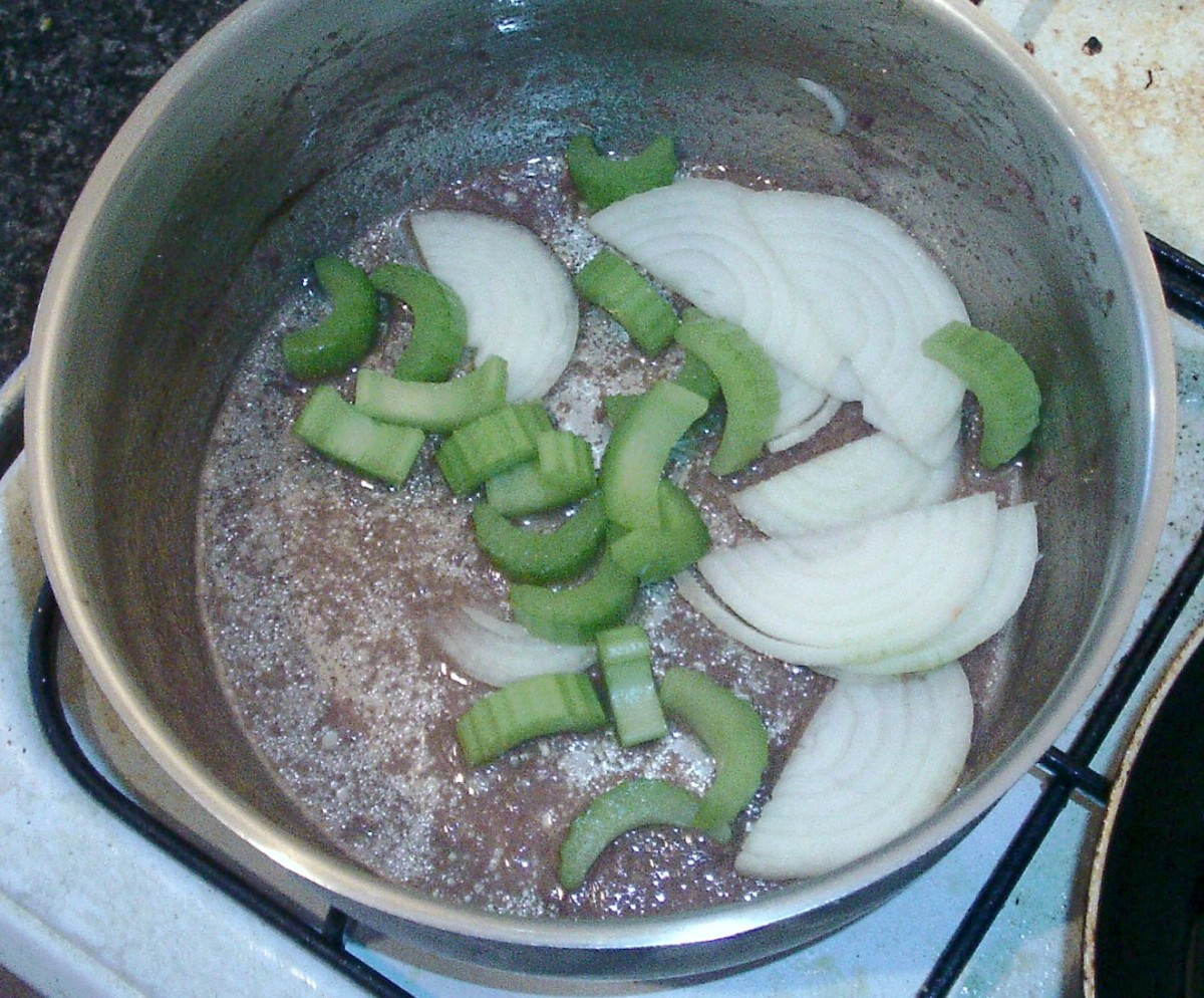 Celery and onion are added to pot for softening