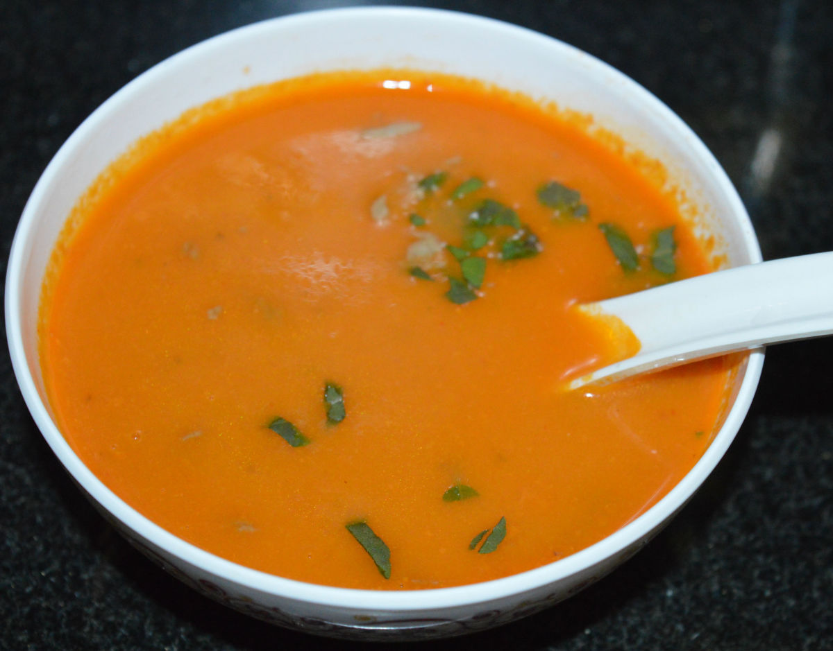 Enjoy sipping this flavorful and creamy vegan tomato soup!