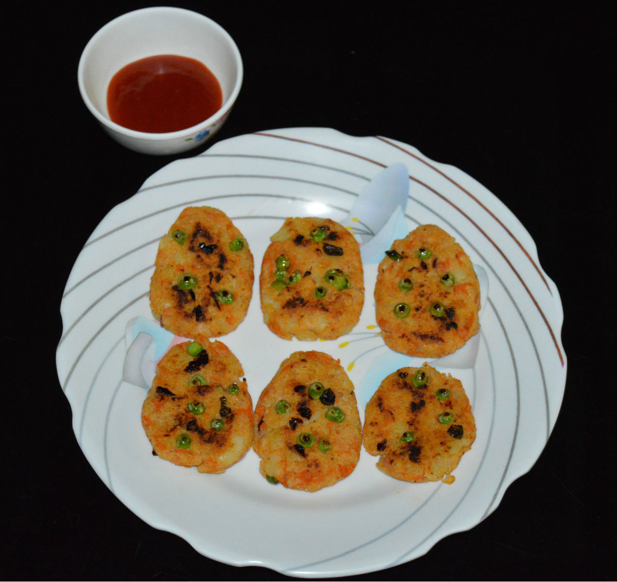 Serve hot idli cutlets with tomato ketchup on the side. Enjoy eating this yummy and nutritious snack!