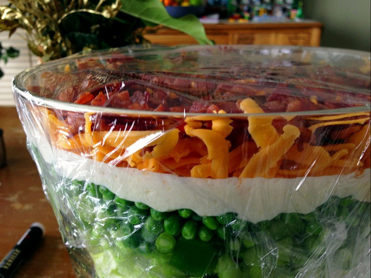 A layered salad in a clear bowl.
