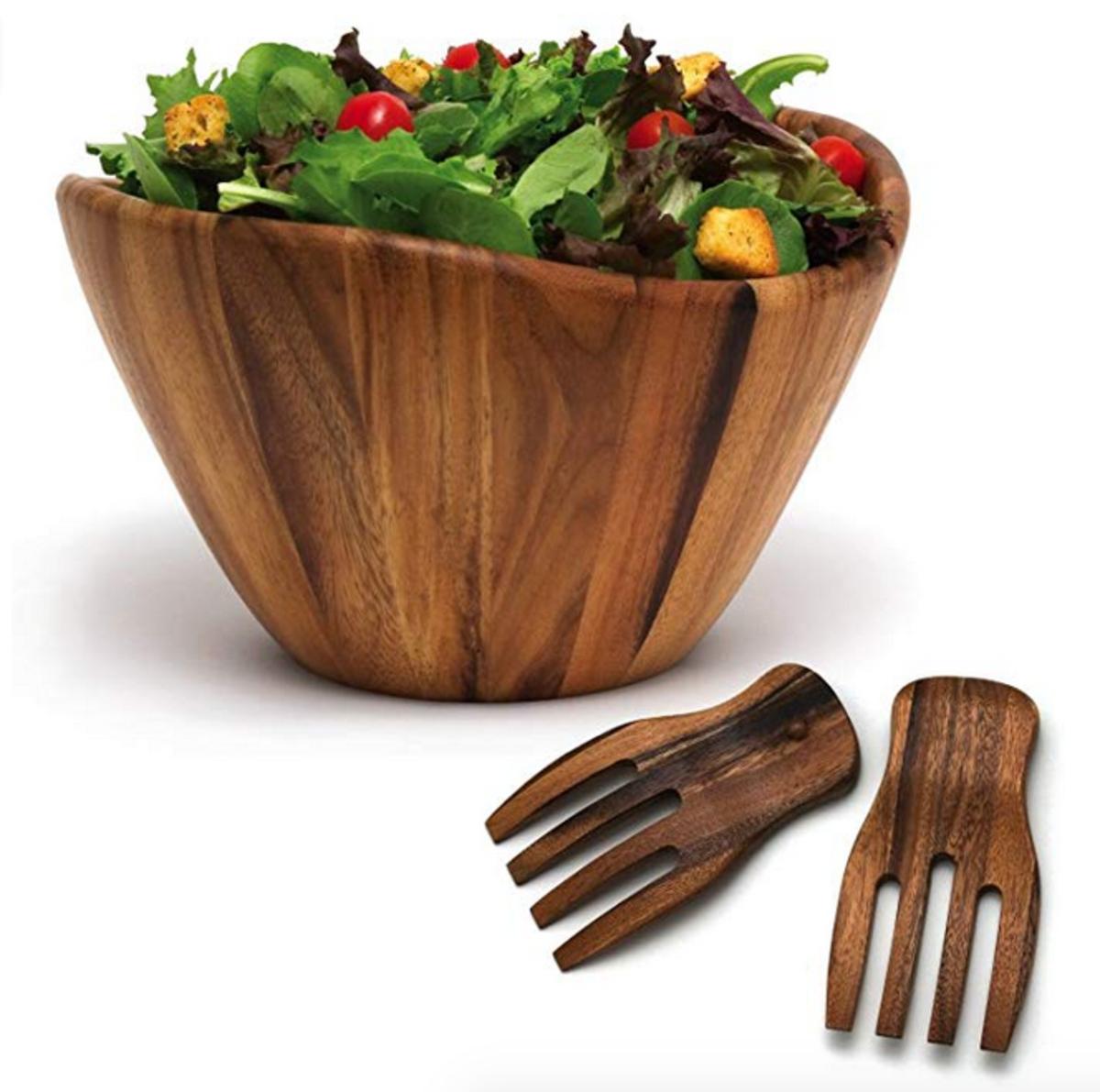 A wooden salad bowl and tongs.