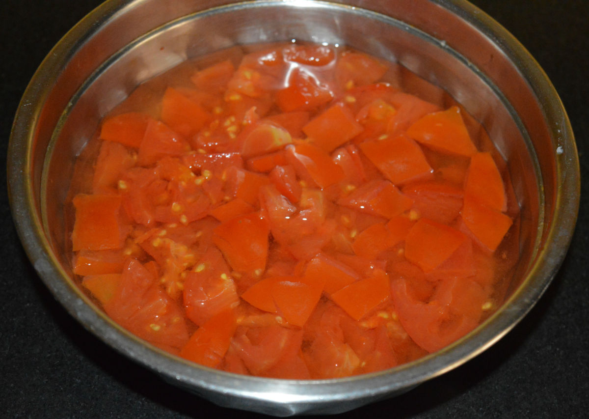 Step two: Cook chopped tomatoes with some water. I cooked them in a pressure cooker. Keep aside.