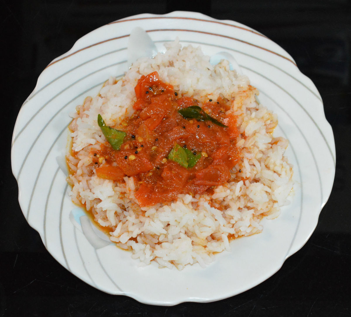 Boiled tomato gojju with steamed rice