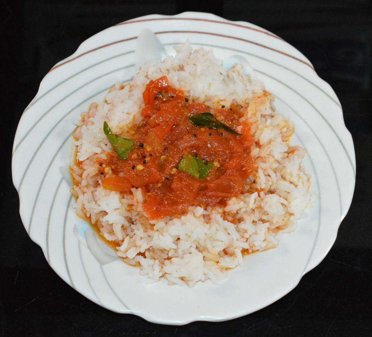 Boiled tomato gojju with steamed rice