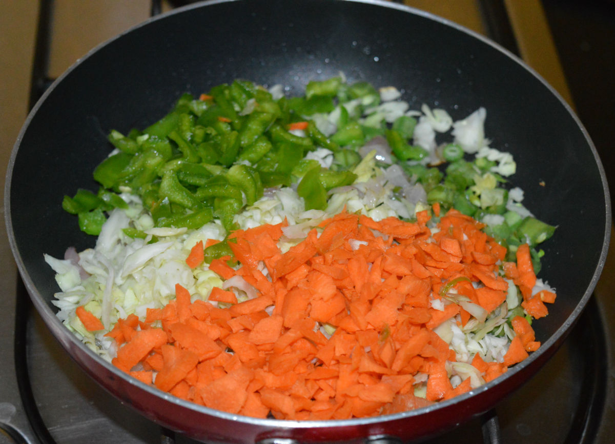 Step three: Add all the veggies and a bit of salt. Saute over high heat until veggies become soft yet retain crunchiness.
