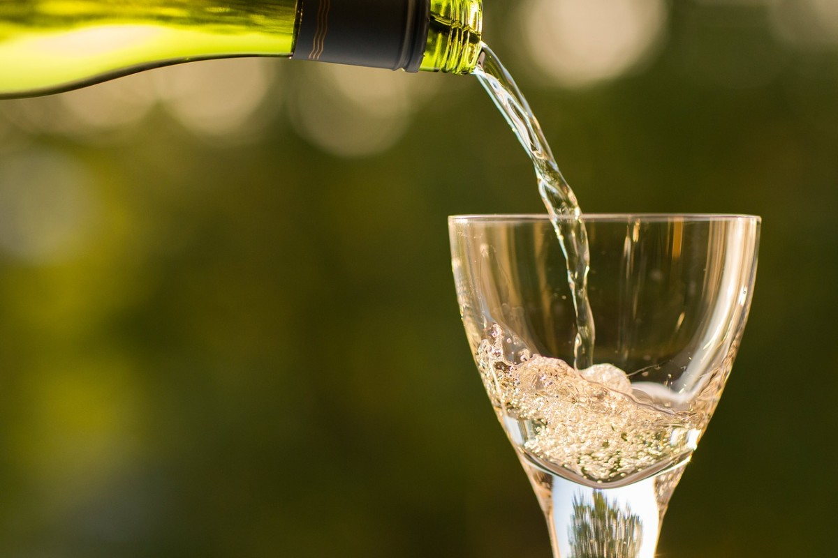 Pouring bubbly into a white wine glass