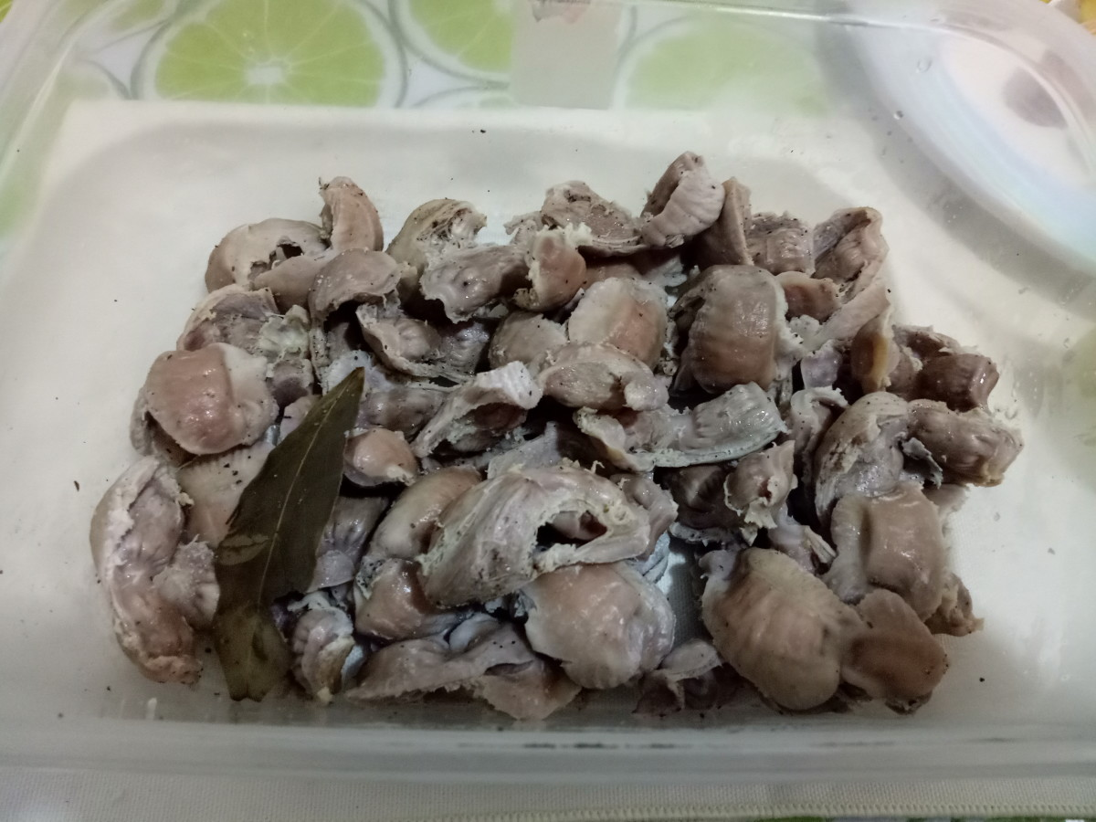 Drain the excess water; then marinate the gizzards in an olive oil, salt, and pepper