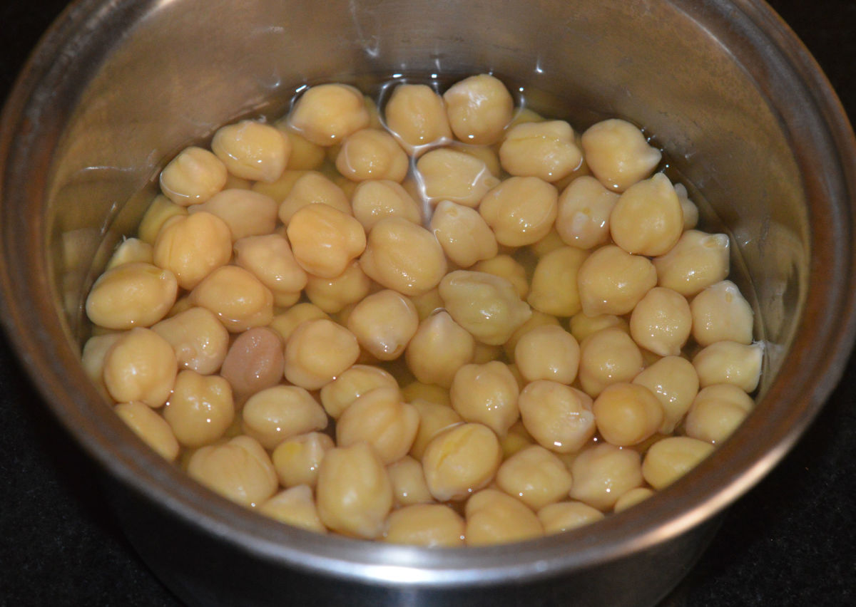 Step one: Soak chickpeas (garbanzo beans) overnight. Cook them with a little salt and water. If cooking in a pressure cooker, cook until 4 whistles and simmer for 10 minutes.