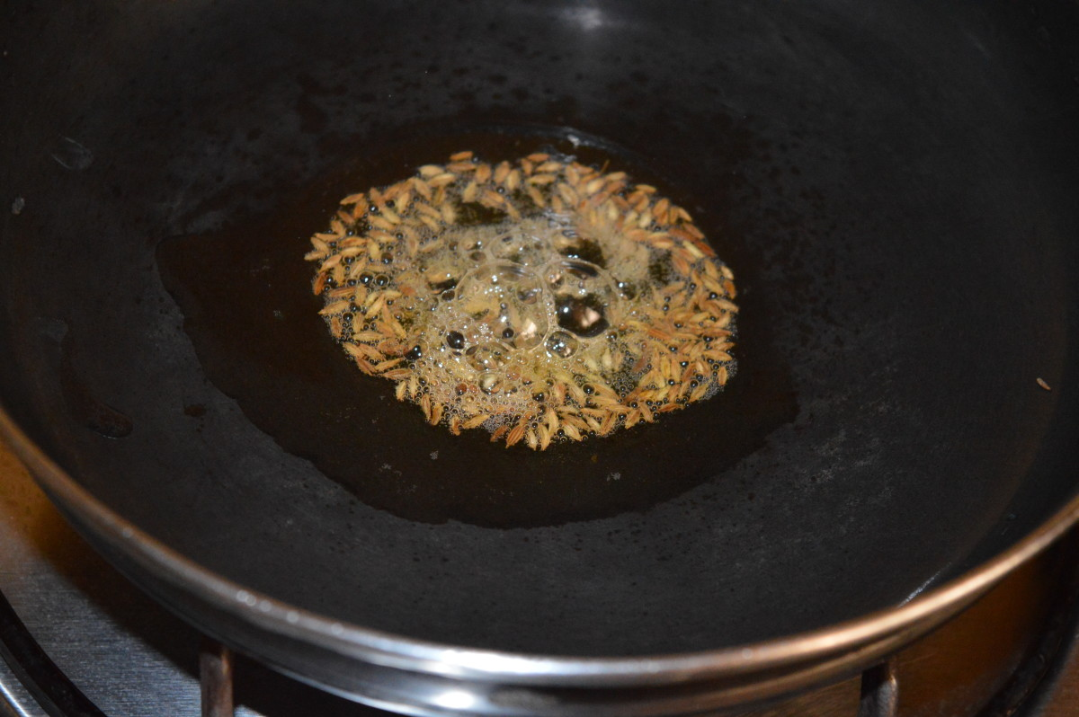 Step two: Heat oil in a deep-bottomed pan. Throw in cumin seeds. Let them crackle.