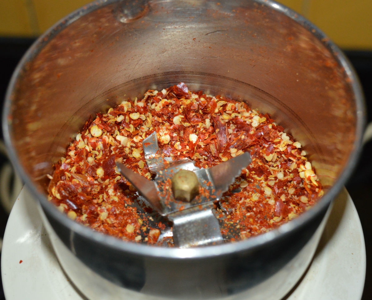 Step two: Pulse the mixer 2-3 times for very short period. Otherwise, if you run it for a longer time, you may get chili powder instead of chili flakes. You should be careful in this step. Pulse until you get the needed consistency.