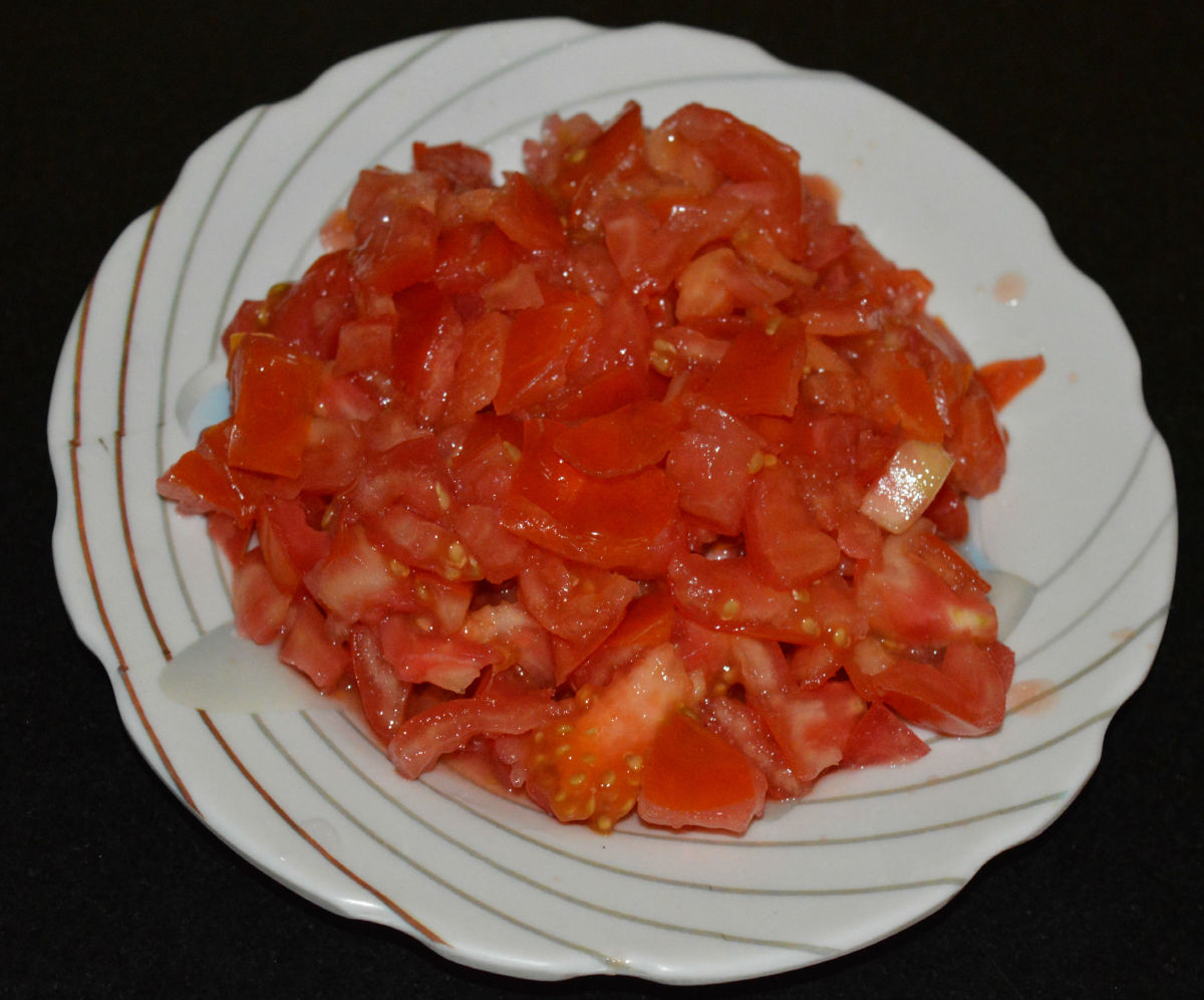 Step one: Finely chop tomatoes.