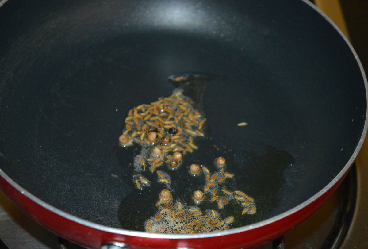 Step 1: Heat 1/2 teaspoon of ghee in a deep-bottomed pan. Throw in cumin seeds and peppercorns. Let cumin sizzle.