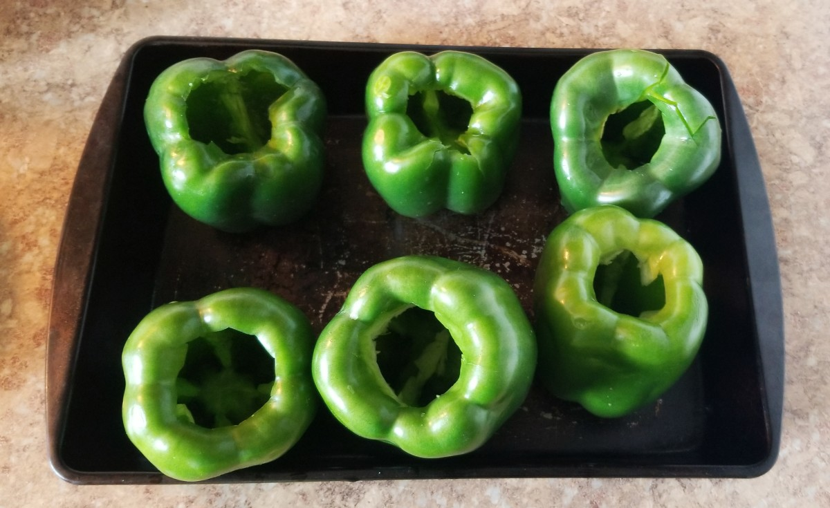 Cut tops off of green peppers and remove seeds.
