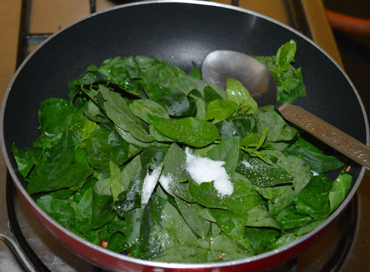 Different stages of sauteing the veggie greens