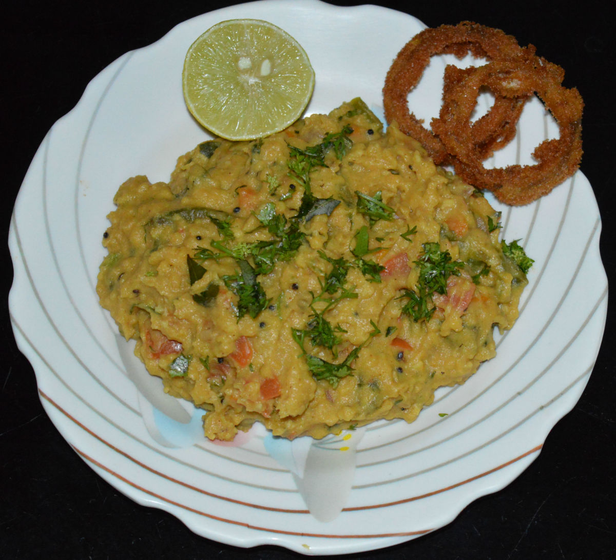 Your favorite cornmeal upma is ready! serve it hot as is or top it with some fried tidbits. Enjoy the taste!